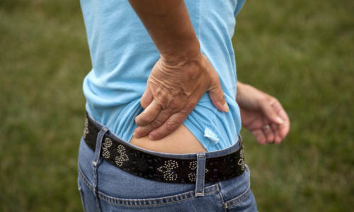 What to do about low back pain ... and it's usually not drugs or surgery - Featured Image