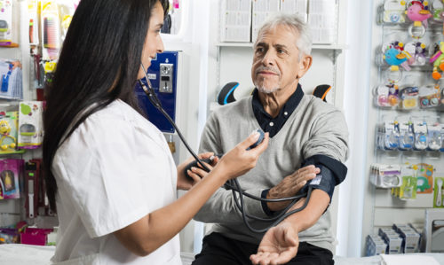 GPs and pharmacists row over health checks - Featured Image